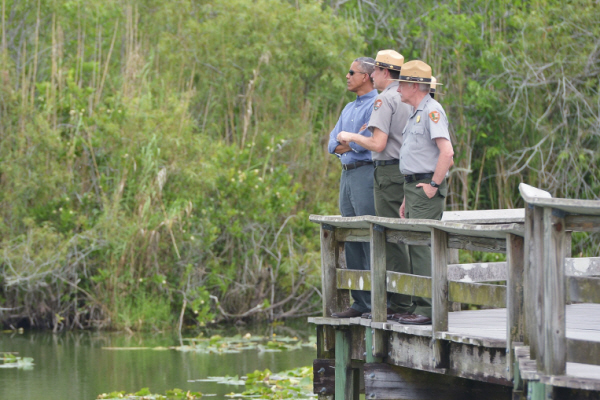 """And here in the Everglades, you can see the effect of a changing climate.  As sea levels rise, salty water from the ocean flows inward.  And this harms freshwater wildlife, which endangers a fragile ecosystem.  The saltwater flows into aquifers, which threatens the drinking water of more than 7 million Floridians.  South Florida, you're getting your drinking water from this area, and it depends on this.  And in terms of economic impact, all of this poses risks to Florida's $82 billion tourism industry on which so many good jobs and livelihoods depend."" (Susan Walsh