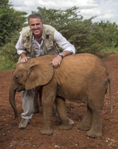 Ron Magill with a baby elephant